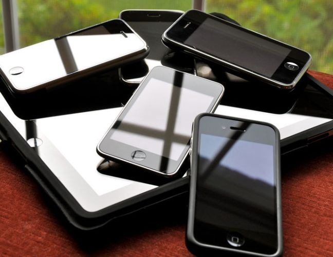 A pile of smartphones and tablets